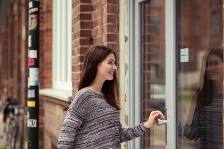 Woman Entering Door