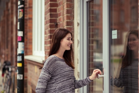 Woman entering a door