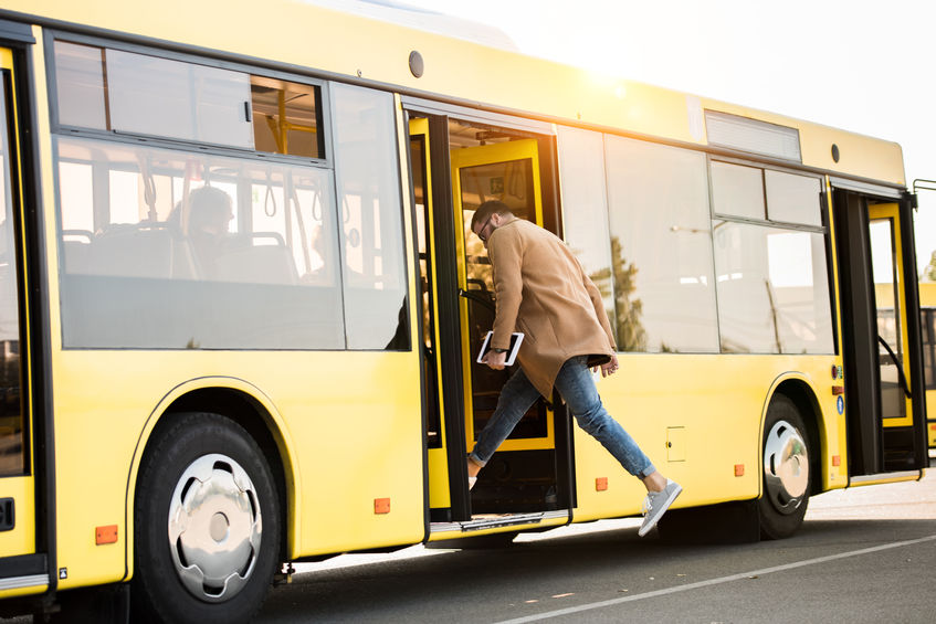 Man Boarding a Bus