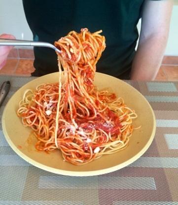 A big bite of spaghetti