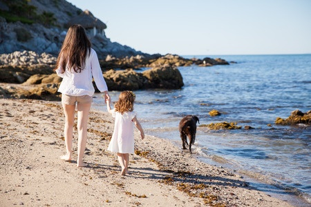 Young Woman and Little Girl on the Beach