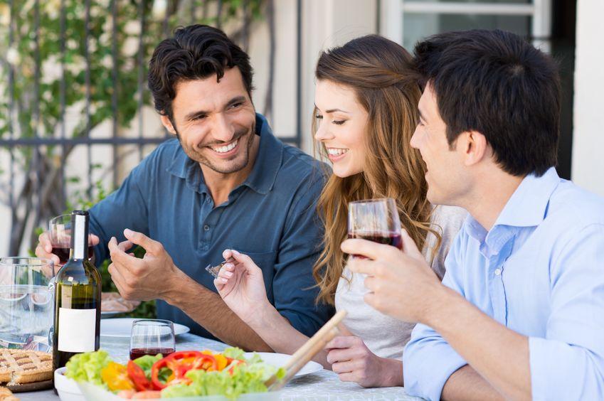 Friends Having Dinner Outdoors