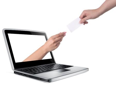 Hands reaching through computer