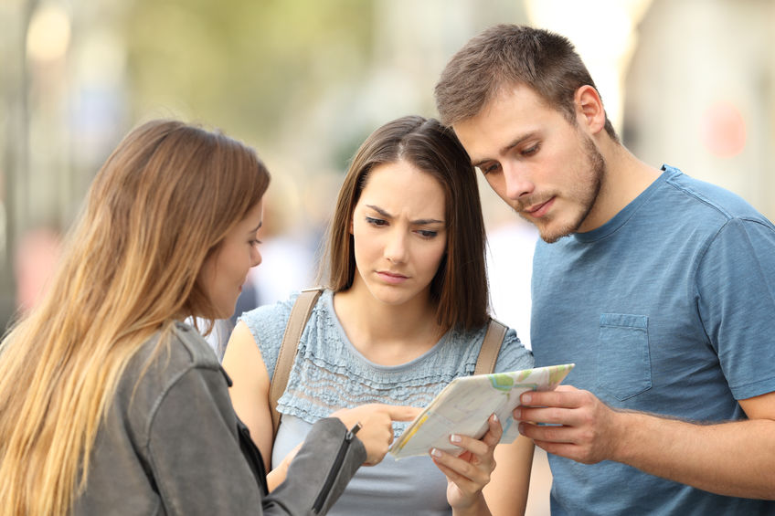 Woman Helping Couple with Directions