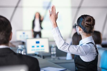 Woman Raising Her Hand to Speak